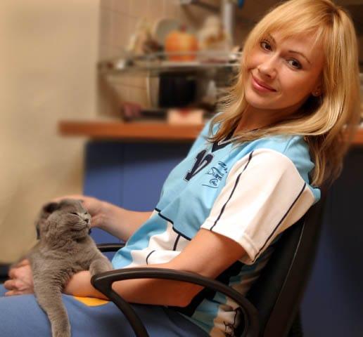 maria butyrskaya sitting with cat on lap